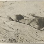 aboriginal child asleep-coolamon