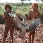 Proud Aboriginal boys holding a bush turkey