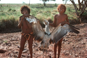 Proud Aboriginal boys holding a bush turkey