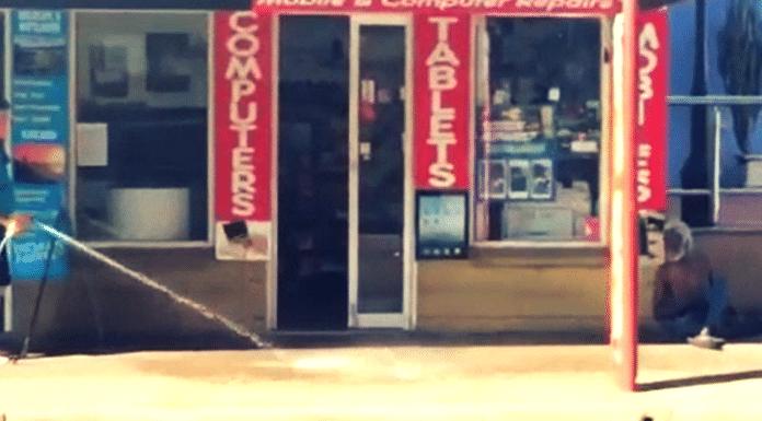 darwin shop owner caught hosing aboriginal man hose australia spraying water