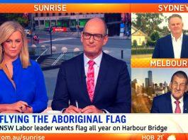 sunrise aboriginal flag sydney harbour bridge debate