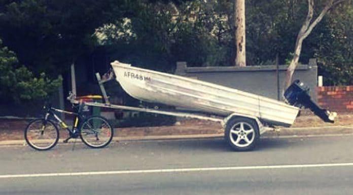 fishing boat towed with bicycle sydney jahmarley dawson
