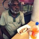 apartheid darwin aboriginal man hot dog