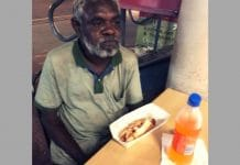 apartheid darwin aboriginal man hot dog